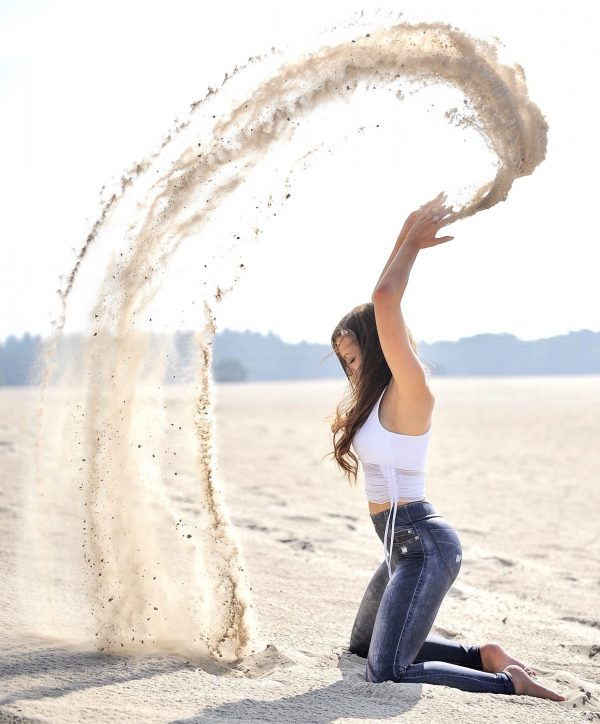 Fitgirl creates a sand swirl in the sky