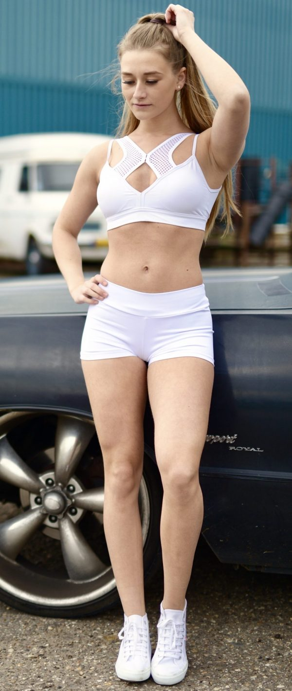 Blonde fitgirl wearing white sportswear