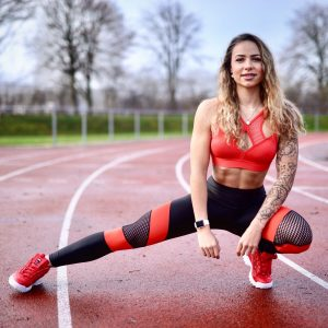 Fitgirl wearing black and red Rolamoca Sportswear