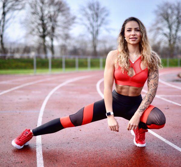 Fitgirl wearing black and red Rolamoca Sportswear