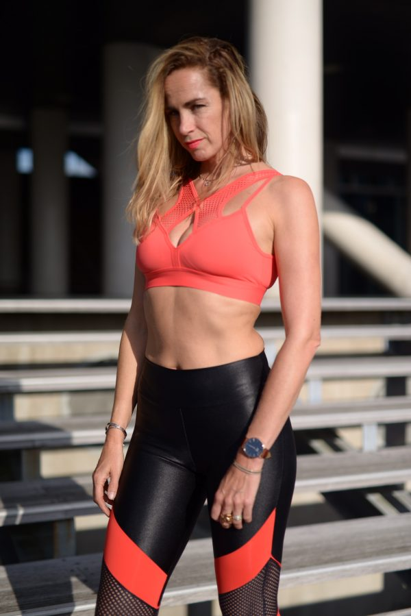 Fitgirl wearing black and red sportswear
