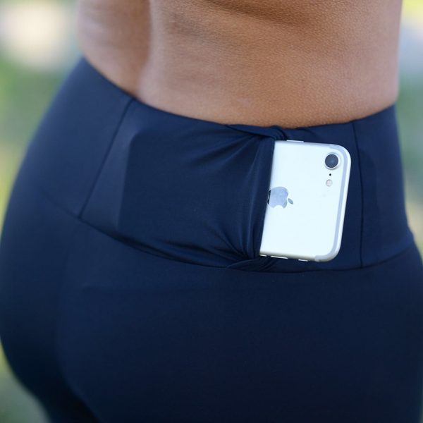 Black and red Rolamoca sports legging Holding phone