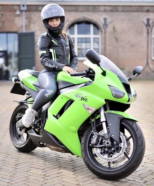 Tanja sitting on her Kawasaki Ninja motorcycle