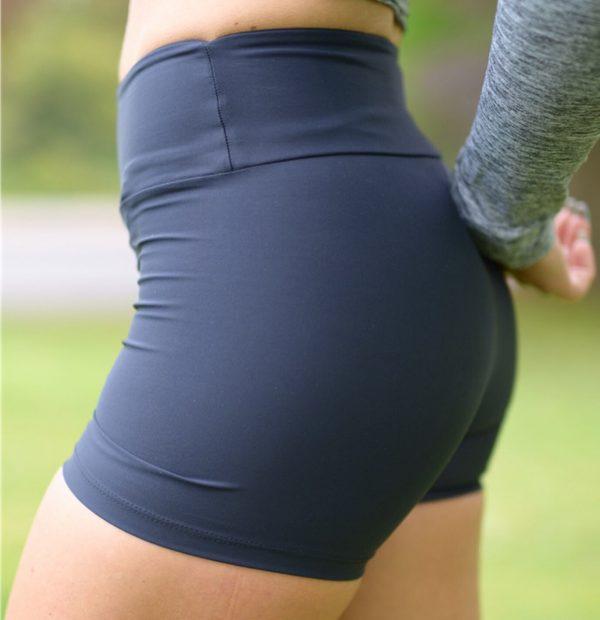 Fitgirl wearing Rolamoca Shorts left side
